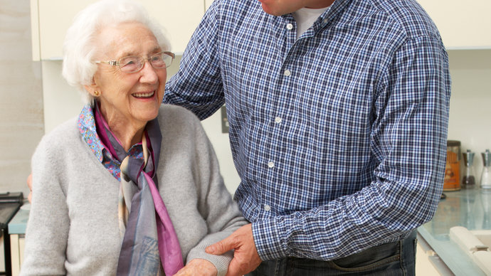 Male carer with older woman